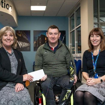 Alan Izzard receives the proceeds from the book sale from Professor Annette McIntosh Scott and Dr Val Gant