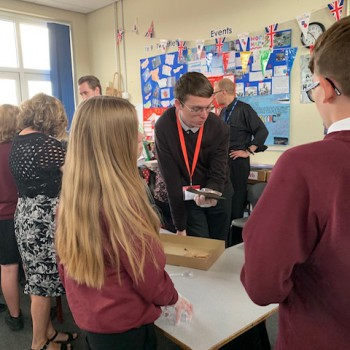 Students at Elfed High School in Buckley examining a medieval shoe.
