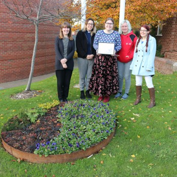 Chaplaincy staff and students of the University at the Fairtrade floral display.