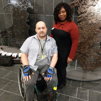 Sondra Butterworth with Alan Thomas, Founder of Ataxia and Me. Ataxia is a rare neurological disease. Sondra also volunteers for Ataxia and Me.  (They are pictured before lockdown, at the Rare Disease Day Senedd Reception in Cardiff, on February 25)