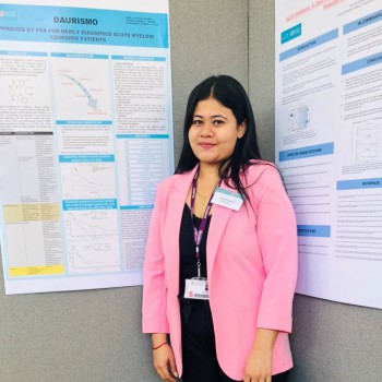 Aastha Solanki presenting her poster