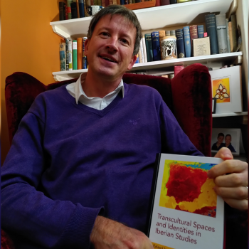 Associate Professor Mark Gant, with his new co-edited work, Transcultural Spaces and Identities in Iberian Studies.