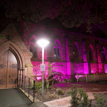 The University of Chester Chapel lit up in purple.