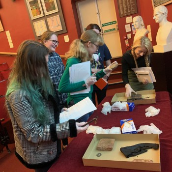 Students with everyday historical objects at the Grosvenor Museum in 2019.