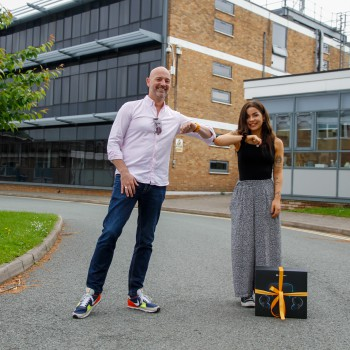 Product Design student Rose Meredith being presented with the Evoke Creative prize by its CEO, Neil Clark.