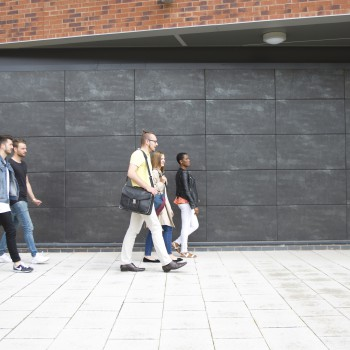 Chester students walking in Parkgate Road campus