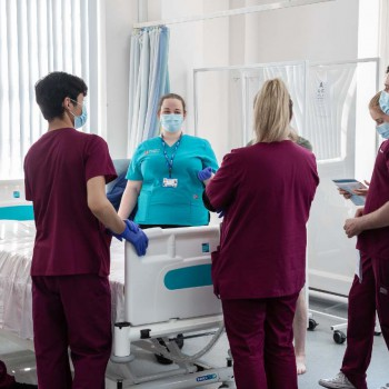 A group of physicians in training ward setting