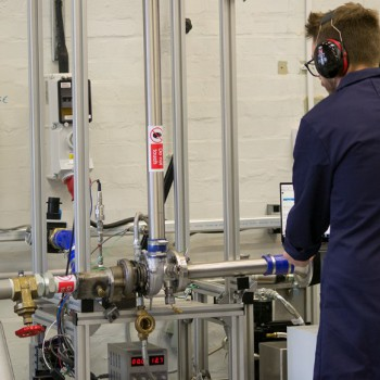 Student Ryan Gunning working on the turbocharger test rig at Thornton Science Park