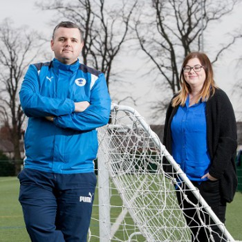 Jim Green, Chief Executive of Chester FC Community Trust, and Sophie Cowell, PhD student at the University of Chester and Kick It Out ASPIRE group member, at the University of Chester.