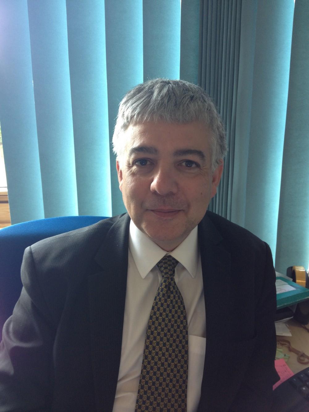 Professor John Alcolado