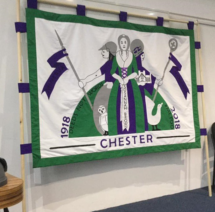 The unveiling of the centenary banner celebrating 100 years of votes for women in Chester.