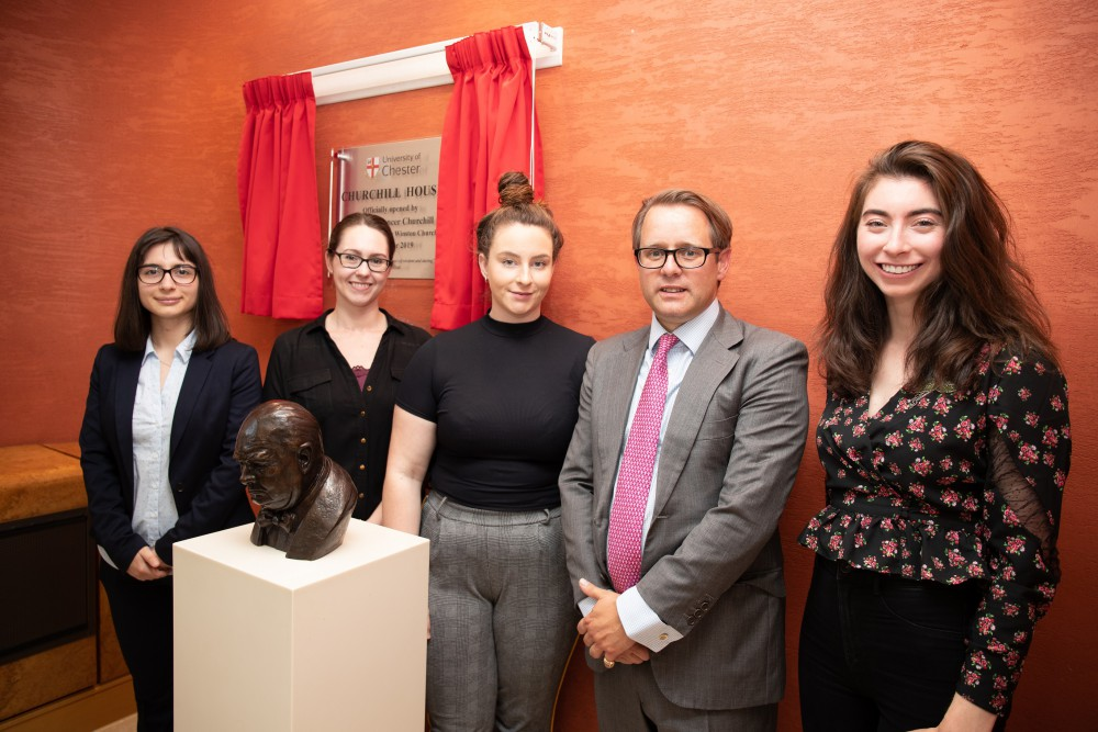 Left to right, University of Chester Business School students, Franceska Shollo, Cheryl Sorensen, Chloe Tonge, and Jessica Kelly (right) with Jack Churchill.