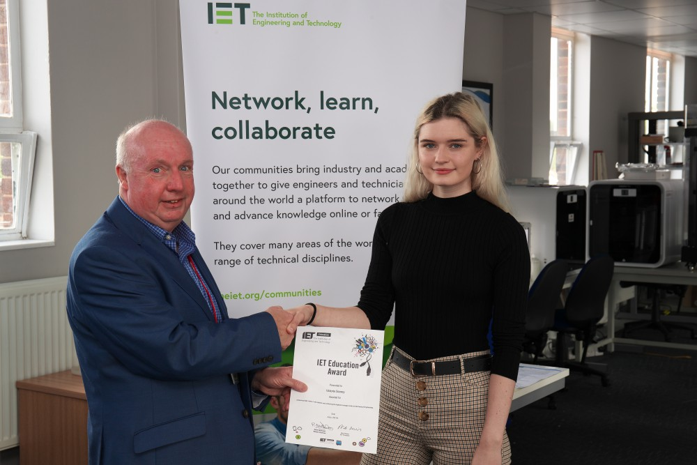 Victoria Scorey receiving her award from Robert McDonald, the Deputy Chair of the IET local network.