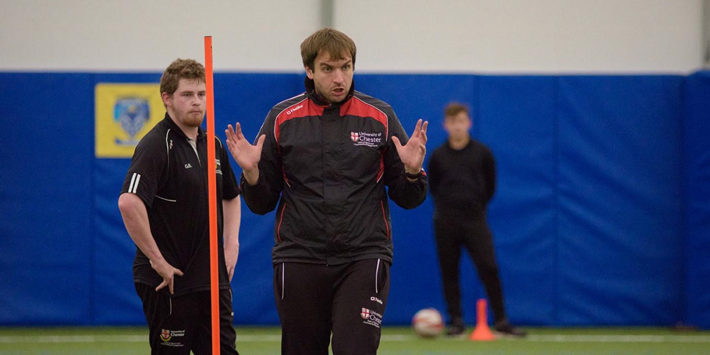 Football coach motivates students