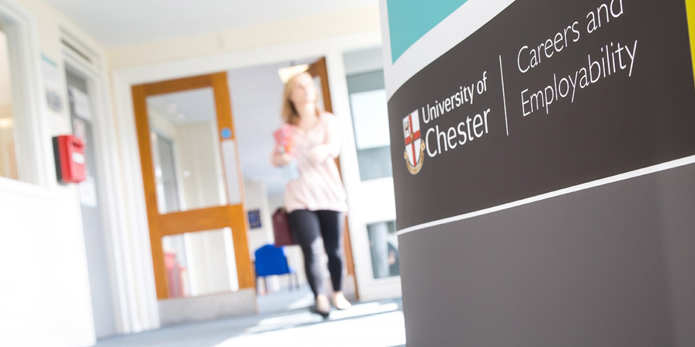 A student walks from Warrington careers office