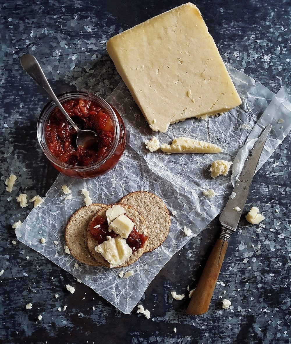 Cheese, crackers and chutney on a kitchen table