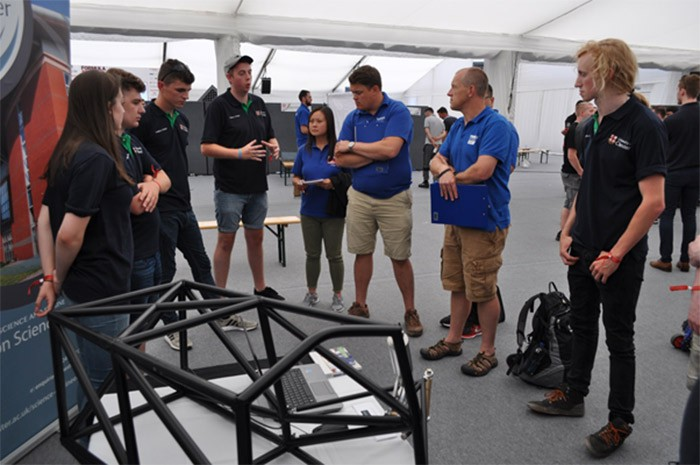 Student Ben McIlhagga, explaining the chassis design to judges, 2018.